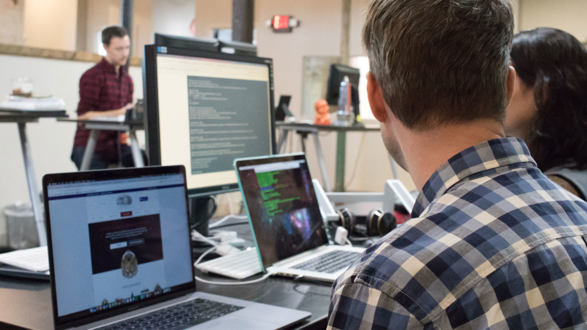 O3 World Developers Collaborating on Laptops
