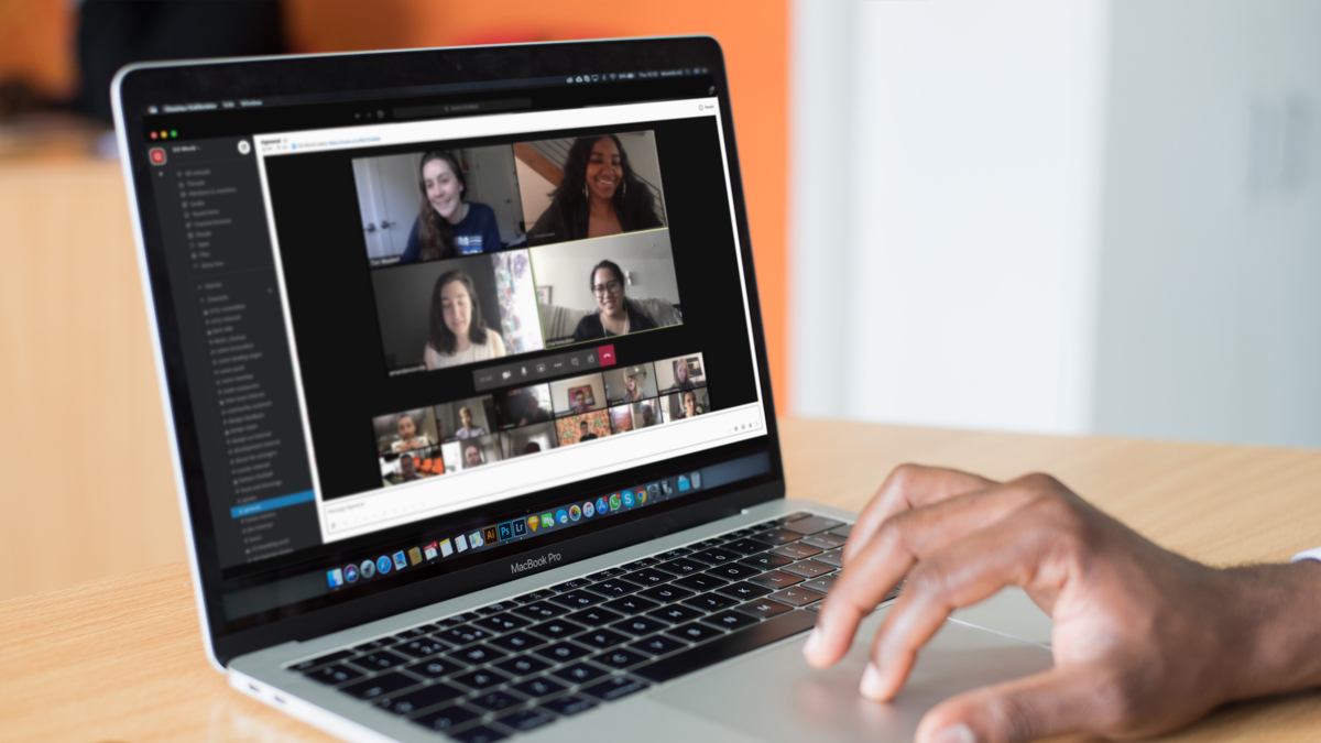 Image of laptop user on a video call with many people